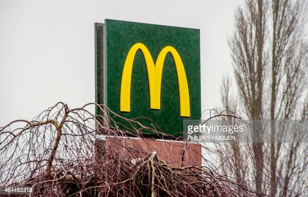 The McDonald's logo is seen above the fastfood outlet on February 26 2015 in Lille northern France Several labour unions and a charity have formally...