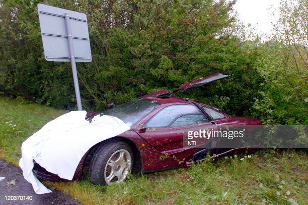 The McLaren F1 supercar of actor Rowan Atkinson is removed from the scene following a crash August 4 2011 in Peterborough England Atkinson pulled...