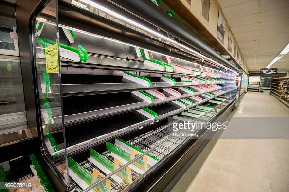 The meat case sits empty at Colella's Supermarket in Hopkinton Massachusetts US on Saturday March 7 2015 Colella's Supermarket is a place the world...