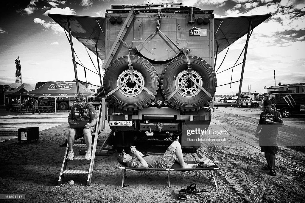 The mechanics take a break from work on truck (#506) for Andrey Karginov, Andrey Mokeev and Igor Devyatkin of Russia for Kamaz - Master during Day 4 of the 2014 Dakar Rally on January 8, 2014 in Chilecito, Argentina.
