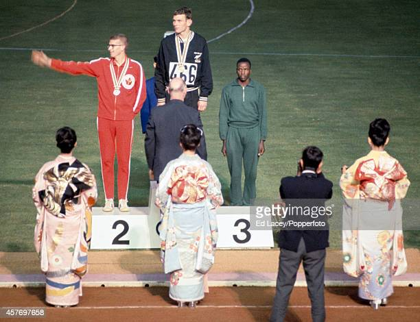 The medal presentation ceremony for the men's 800 metres event featuring left to right Bill Crothers of Canada Peter Snell of New Zealand and Wilson...