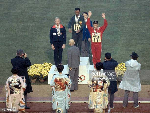 The medal presentation ceremony for the men's marathon featuring left to right Basil Heatley of Great Britain Abebe Bikila of Ethiopa and Kokichi...
