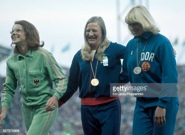 The medal presentation ceremony for the pentathlon event featuring left to right Heide Rosendahl of West Germany Mary Peters of Great Britain and...