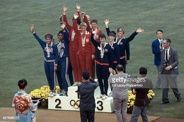 The medal presentation ceremony for the women's 4x100 metres relay event featuring left to right the teams of the United States Poland and Great...
