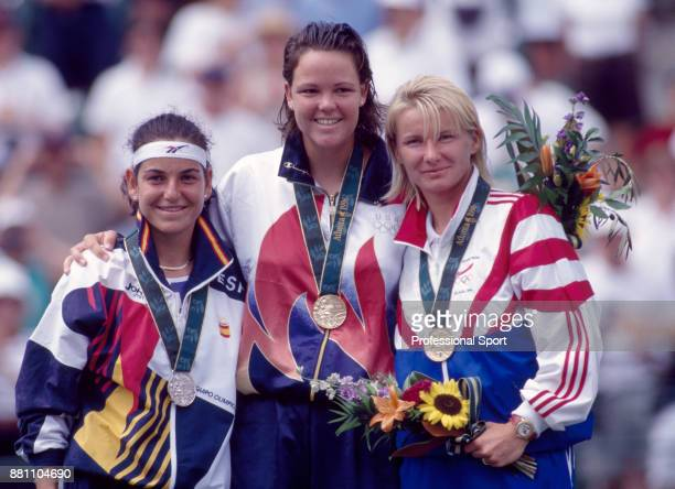 The medal winners in the Women's Singles event Arantxa Sanchez Vicario of Spain Lindsay Davenport of the USA and Jana Novotna of the Czech Republic...