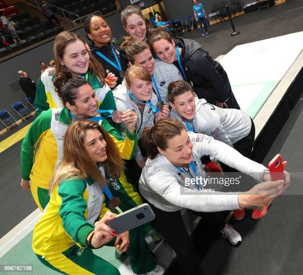 The medal winners of the Team Women's Epee event from Brazil USA and Canada pose for a selfie on the podium on June 16 2017 at the PanAmerican...