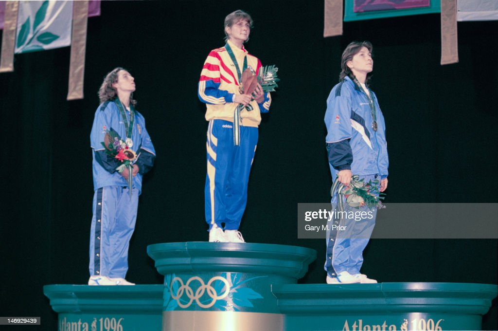 The medalists on the podium after the women's foil event at the Georgia World Congress Center, during the Atlanta Olympics, Georgia, USA, 22nd July 1996. Left to right: <a gi-track='captionPersonalityLinkClicked' href=/galleries/search?phrase=Valentina+Vezzali&family=editorial&specificpeople=772094 ng-click='$event.stopPropagation()'>Valentina Vezzali</a> of Italy (silver), Laura Badea of Romania (gold) and Giovanna Trillini of Italy (bronze).