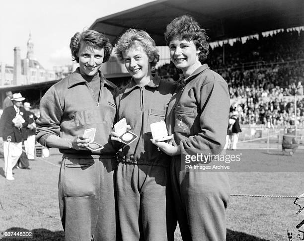 The medallists in the women's 220yds dash show off their spoils Great Britain's Heather Armitage Australia's Betty Cuthbert and Australia's Marlene...