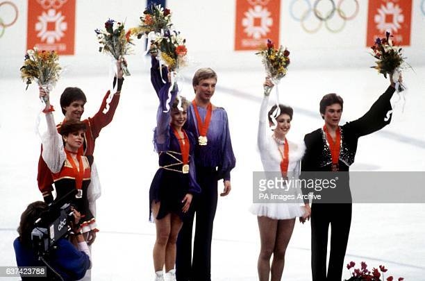 The medallists on the podium gold medallists Jayne Torvill and Christopher Dean of Great Britain silver medallists Natalya Bestemianova and Andrei...