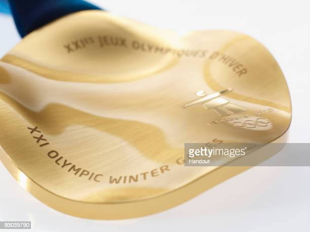 The medals of the Vancouver 2010 Olympic Winter Games are circular in shape and based on a large master artwork of an orca whale by Corrine Hunt a...
