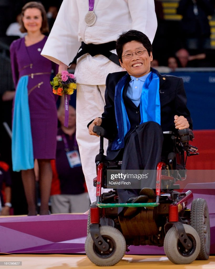 The medals were presented by IPC Member and former President of the Korean Paraplegic Association, Mrs Hyang-Sook Jana of Korea in her motorised wheelchair during the u100kgs medal ceremony on Day 3 of the London 2012 Paralympic Games at the ExCeL on April 30, 2012 in London, England.