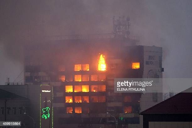 The media building burns as militants attack in central Grozny on December 4 2014 Several police died in clashes with militants who attacked a...