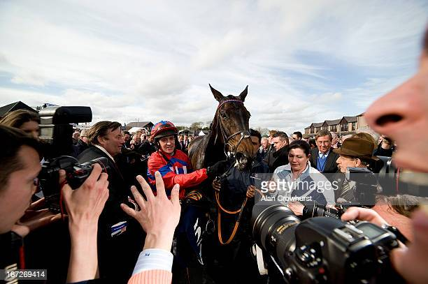 The media gather after Barry Geraghty riding Sprinter Sacre win The Boylesportscom Champion Chase at Punchestown racecourse on April 23 2013 in Naas...