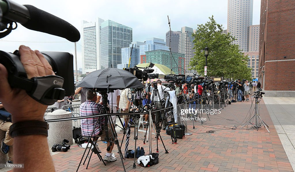 The media gathers outside the John Joseph Moakley United States Courthouse before Boston Marathon bombings suspect Dzhokhar Tsarnaev is charged, on July 10, 2013.