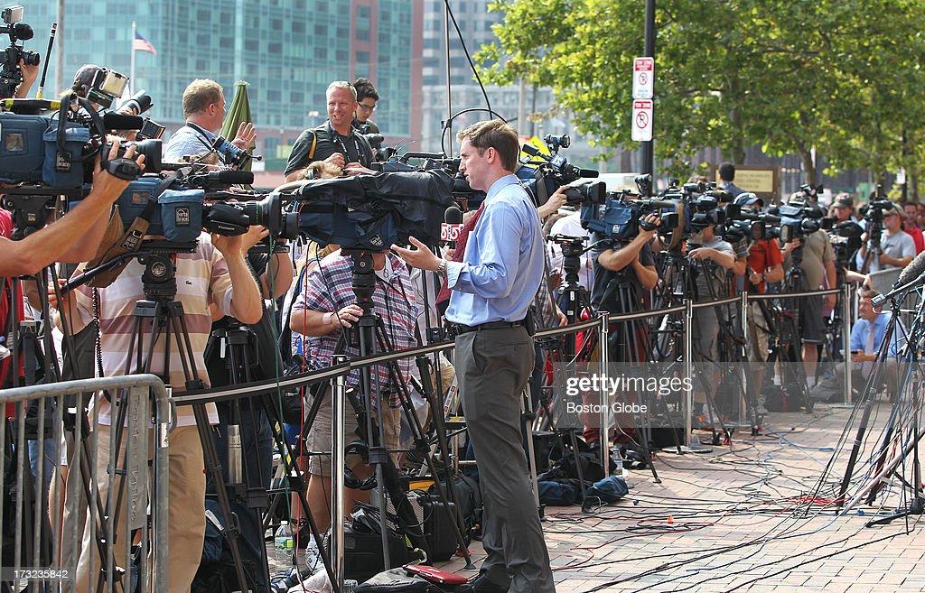 The media gathers outside the John Joseph Moakley United States Courthouse during the appearance of Boston Marathon bombings suspect Dzhokhar Tsarnaev, on Wednesday, July 10, 2013.