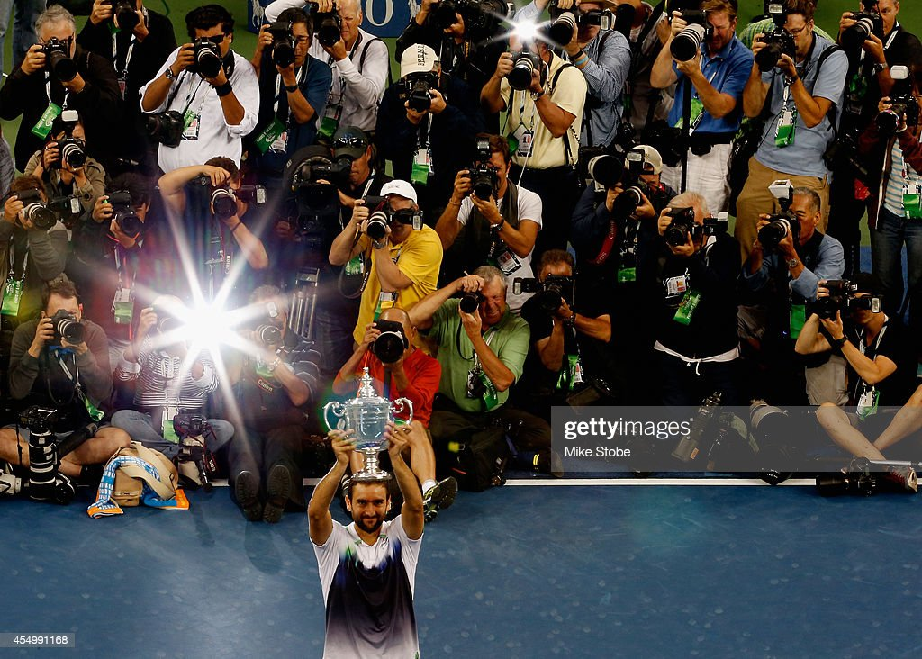 The media photograph <a gi-track='captionPersonalityLinkClicked' href=/galleries/search?phrase=Marin+Cilic&family=editorial&specificpeople=553788 ng-click='$event.stopPropagation()'>Marin Cilic</a> of Croatia as he celebrates with the trophy after defeating Kei Nishikori of Japan to win the men's singles final match on Day Fifteen of the 2014 US Open at the USTA Billie Jean King National Tennis Center on September 8, 2014 in the Flushing neighborhood of the Queens borough of New York City.