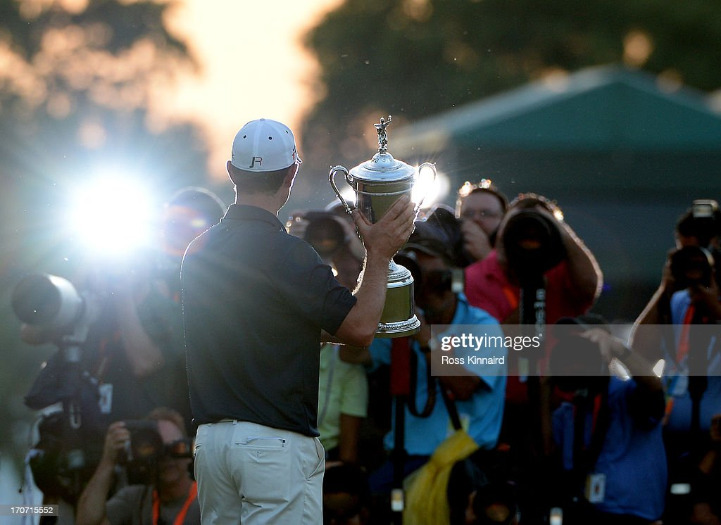 The media photographs <a gi-track='captionPersonalityLinkClicked' href=/galleries/search?phrase=Justin+Rose&family=editorial&specificpeople=171559 ng-click='$event.stopPropagation()'>Justin Rose</a> of England as he celebrates with the U.S. Open trophy after winning the 113th U.S. Open at Merion Golf Club on June 16, 2013 in Ardmore, Pennsylvania.