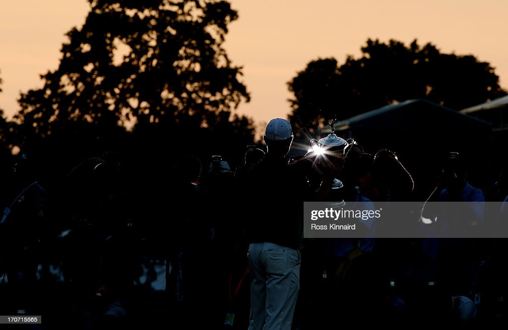 The media photographs Justin Rose of England as he celebrates with the U.S. Open trophy after winning the 113th U.S. Open at Merion Golf Club on June 16, 2013 in Ardmore, Pennsylvania.