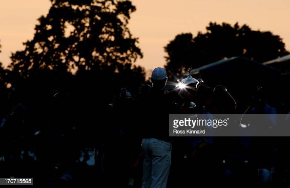 The media photographs Justin Rose of England as he celebrates with the US Open trophy after winning the 113th US Open at Merion Golf Club on June 16...