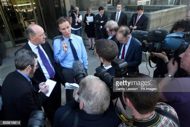 The media surround Scottish Finance Secretary John Swinney and Scottish Secretary Jim Murphy following a meeting at St Andrews House in Edinburgh