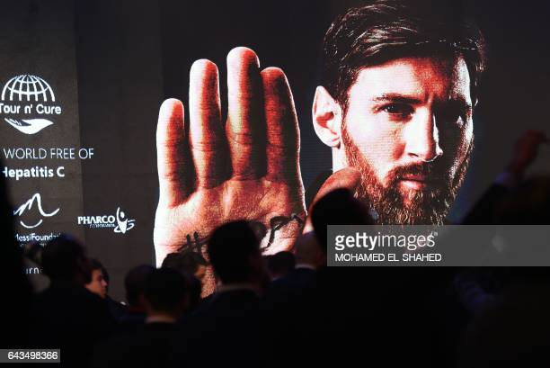 The media wait for Barcelona's Argentinian striker Lionel Messi to arrive for a press conference in Cairo's northern Giza district on February 21...