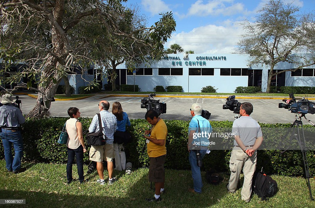 The media waits outside as FBI agents and other law enforcement officials investigate the medical-office complex of Dr. Salomon Melgen who has possible ties to U.S. Sen. Bob Menendez (D-NJ) on January 30, 2013 in West Palm Beach, Florida. The agents arrived last night at the medical-office complex and started hauling away potential evidence in several vans.