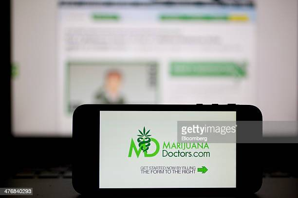 The Medical Cannabis Network Inc MarijuanaDoctorscom video and website are displayed on an Apple Inc iPhone 5s and laptop computer in this arranged...