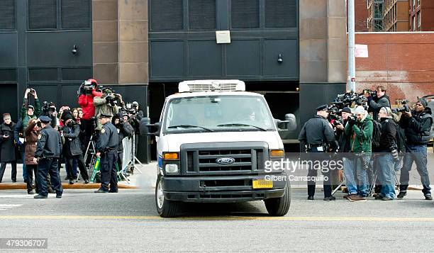 The Medical Examiner's van is seen leaving the scene of the Chelsea apartment building on March 17 2014 in New York City where fashion designer...
