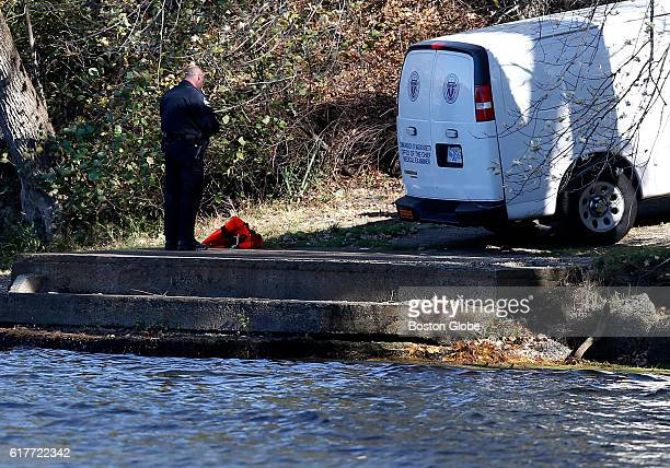 The medical examiners van takes away a body found in the Merrimack River in Tyngsborough Mass Oct 23 2016