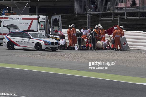 The medical staff help Luis Salom of Spain and SAG Team after the crashed out during the free practice during the MotoGp of Catalunya Free Practice...