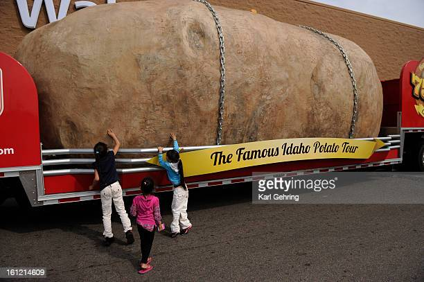 The Medina sisters from left Samantha age 8 Aileene age 3 and Jezebel age 6 touched a 12130 pound potato Wednesday afternoon outside the Walmart in...