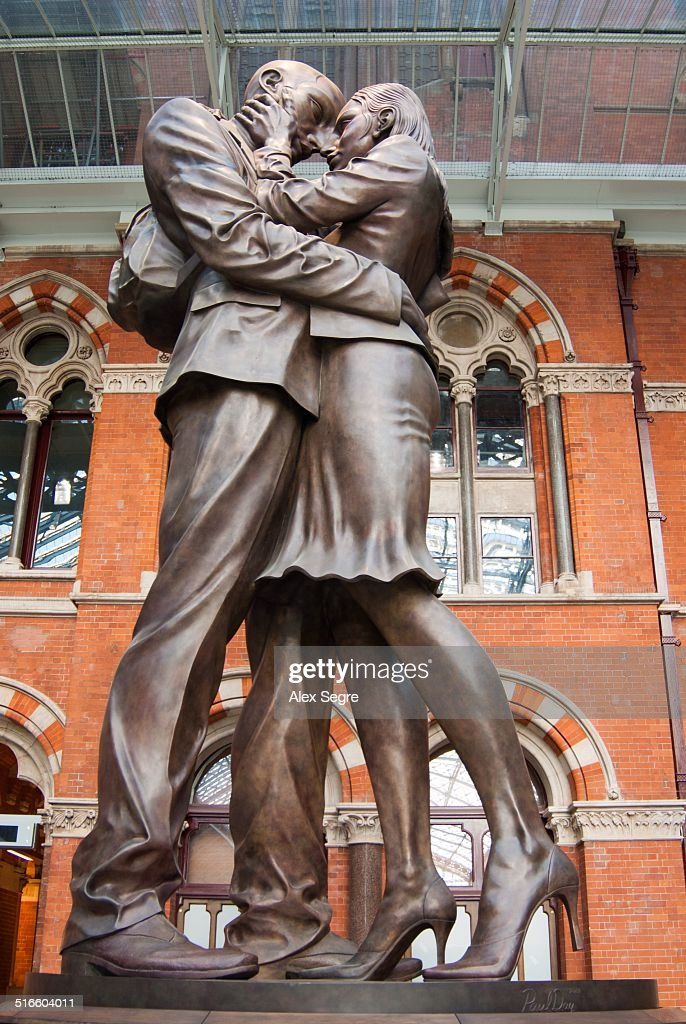 The Meeting Place bronze statue in St Pancras International railway station London UK