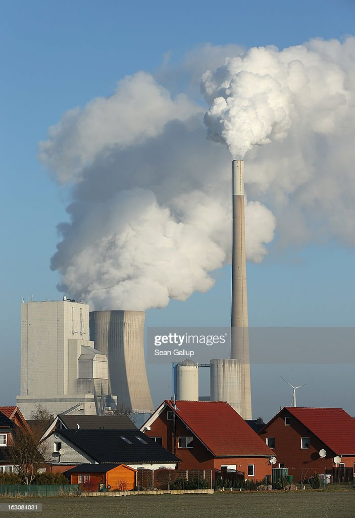The Mehrum coal-fired power plant (Kohlekraftwerk Mehrum) looms over houses on March 4, 2013 in Mehrum, Germany. German Environment Minster Peter Altmaier and Economy Minister Philipp Roesler rcently proposed a set of measures that would cut subsidies to the renewable energy industry, amove industry representatives claim would stifle renewable energy growth. Germany has set ambitious goals for increasing the renewable energies share of domestic power production, yet critics decry the perceived high cost.