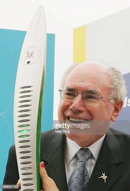 The Melbourne 2006 Commonwealth Games Queen's Baton is pictured with Australian Prime Minister John Howard at Kingsford Smith Airport January 24 2006...