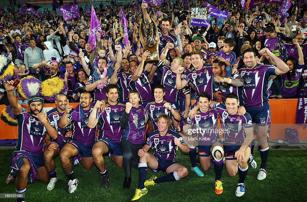The Melbourne Storm team celebrate during the lap of honour after winning the 2012 NRL Grand Final match between the Melbourne Storm and the Canterbury Bulldogs at ANZ Stadium on September 30, 2012 in Sydney, Australia.