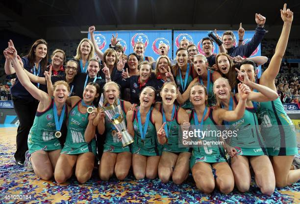 The Melbourne Vixens squad celebrate victory in the ANZ Championship Grand Final match between the Vixens and the Firebirds at Hisense Arena on June...