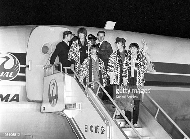 The members of Beatles pose for photographs upon arrival to the Tokyo International Airport on June 29 1966 in Tokyo Japan