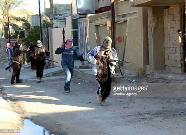 The members of Islamic State of Iraq and the Levant lay siege to the Tuzhurmatu district in Kirkuk Iraq on February 13 2014