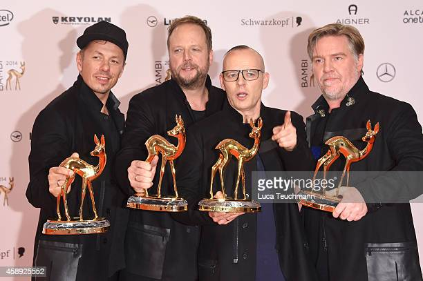 The members of the band Die Fantastischen Vier Michi Beck Smudo Thomas D and Andreas Rieke pose with their award during Kryolan at the Bambi Awards...