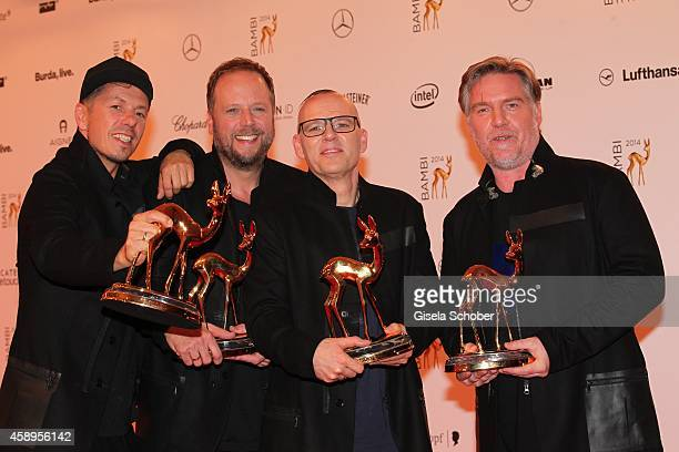 The members of the band Die Fantastischen Vier Michi Beck Smudo Thomas D and Andreas Rieke pose with their award at the winners board during the...