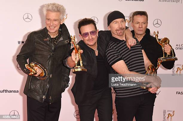 The members of the band U2 Adam Clayton Bono The Edge and Larry Mullen junior pose with their award during Kryolan at the Bambi Awards 2014 on...