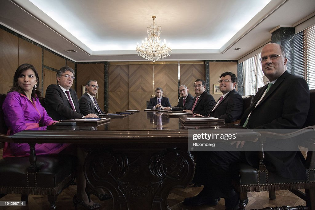 The members of the board of Colombia's Banco de la Republica pose for a photo at the bank's headquarters in Bogota, Colombia, on Friday, March 22, 2013. Seated from left are Ana Fernanda Maiguashca, Colombia's deputy finance minister, Mauricio Cardenas, Colombia's finance minister, Cesar Vallejo, Alberto Boada, an adviser to the bank, Carlos Gustavo Cano, Adolfo Meisel, Juan Pablo Zarate and Jose Dario Uribe, the bank's governor. Central bank policy makers will lower borrowing costs by 25 basis points to 3.5 percent on March 22, according to 29 of 32 analysts and economists surveyed by Bloomberg. Photographer: Jose Cendon/Bloomberg via Getty Images