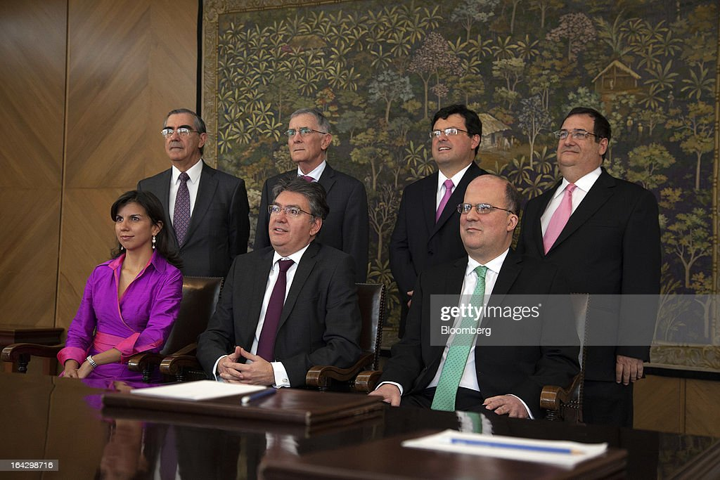 The members of the board of Colombia's Banco de la Republica pose for a photo at the bank's headquarters in Bogota, Colombia, on Friday, March 22, 2013. Seated from left are Ana Fernanda Maiguashca, Colombia's deputy finance minister, Mauricio Cardenas and Jose Dario Uribe, the bank's governor. Standing from left are Cesar Vallejo, Carlos Gustavo Cano, Juan Pablo Zarate and Adolfo Meisel. Central bank policy makers will lower borrowing costs by 25 basis points to 3.5 percent on March 22, according to 29 of 32 analysts and economists surveyed by Bloomberg. Photographer: Jose Cendon/Bloomberg via Getty Images