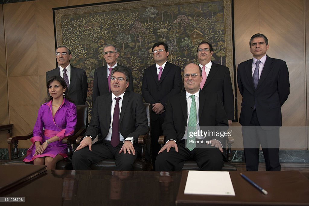 The members of the board of Colombia's Banco de la Republica pose for a photo at the bank's headquarters in Bogota, Colombia, on Friday, March 22, 2013. Seated from left are Ana Fernanda Maiguashca, Colombia's deputy finance minister, Mauricio Cardenas and Jose Dario Uribe, the bank's governor. Standing from left are Cesar Vallejo, Carlos Gustavo Cano, Juan Pablo Zarate, Adolfo Meisel and Alberto Boada, an adviser to the bank. Central bank policy makers will lower borrowing costs by 25 basis points to 3.5 percent on March 22, according to 29 of 32 analysts and economists surveyed by Bloomberg. Photographer: Jose Cendon/Bloomberg via Getty Images