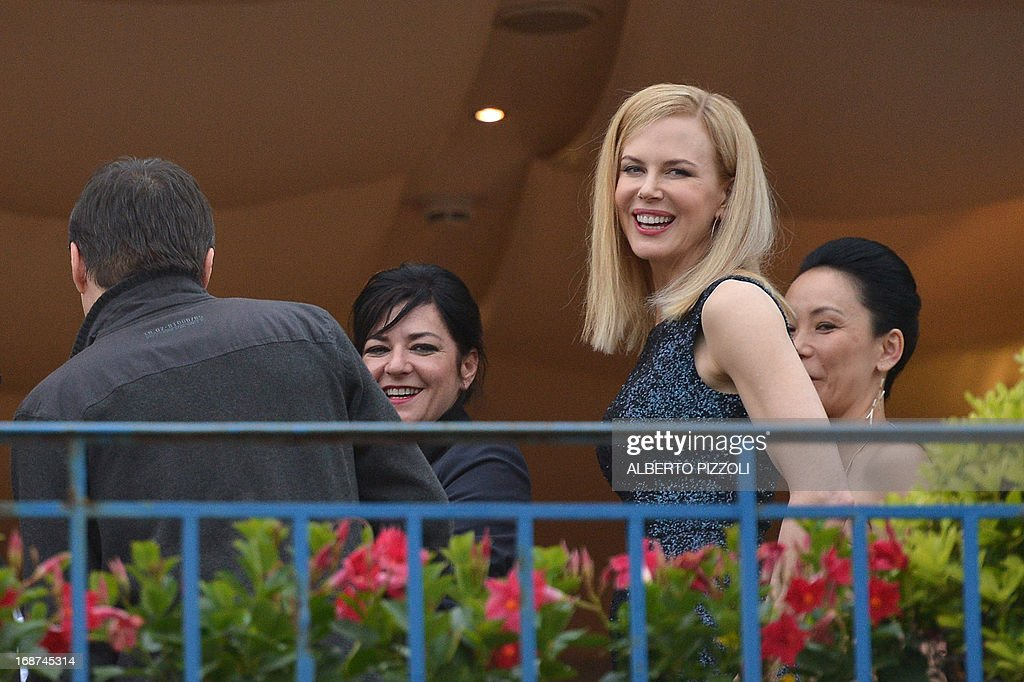 The members of the Feature Film Jury, Australian actress Nicole Kidman (2ndR), Japanese director Naomi Kawase (R), British director Lynne Ramsay (2ndL) and Romanian director Cristian Mungiu pose on May 14, 2013 on the balcony of the Grand-Hyatt Martinez Hotel in Cannes on the eve of the 66th edition of the Cannes Film Festival. Cannes, one of the world's top film festivals, opens on May 15 and will climax on May 26 with awards selected by a jury headed this year by Hollywood legend Steven Spielberg. AFP PHOTO / ALBERTO PIZZOLI