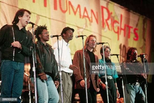 The members of the 'Human Rights Now' world tour sing together in a row at the Los Angeles show From left Peter Gabriel Tracy Chapman Youssou N'Dour...