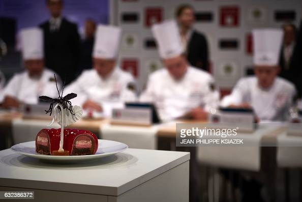 The members of the jury examine a dessert during the Pastries World Cup final on January 22 2017 in Chassieu outside Lyon as part of the Catering and...
