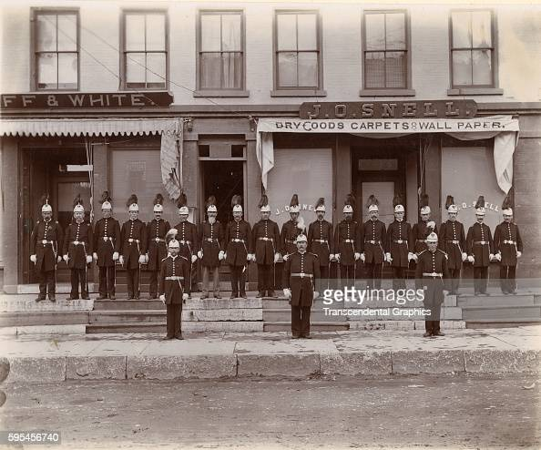 The members of the Knights of Columbus pose together in full uniform Little Falls New York circa 1900