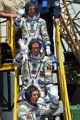 The members of the main international space crew Canadian astronaut Robert Thirsk European Space Agency astronaut Frank De Winne of Belgium and...