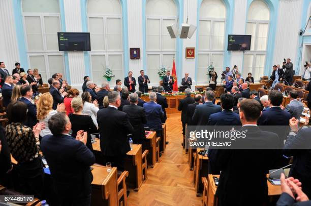 The members of the Montenegro's parliament applaud after approving the NATO membership agreement in Cetinje on April 28 2017 Montenegro's parliament...